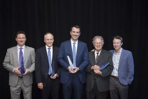 The 2016 Greater Washington CFO Award winners stand with their awards. From left: Kevin Boyce of Ellucian, Pat McCoy of ScienceLogic, David Keffer of CSRA, John May of New Vantage Group and Harry Weller of NEA. (Photo credit: NVTC.org)